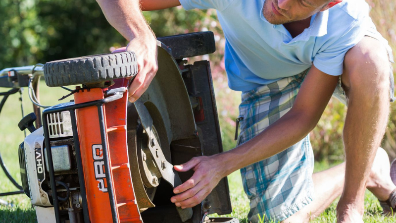 How To Fix A Noisy Lawnmower - lawnmower deck cleaning