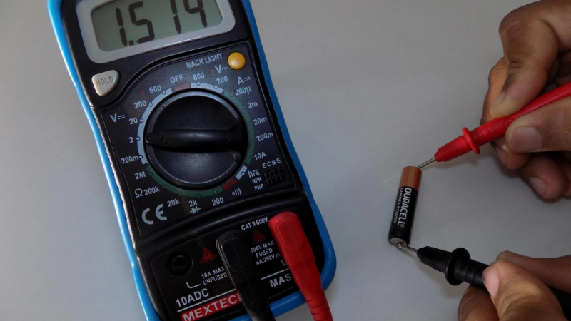 Put the multimeter probe on the positive or red battery terminal while it is set to measure DC voltage
